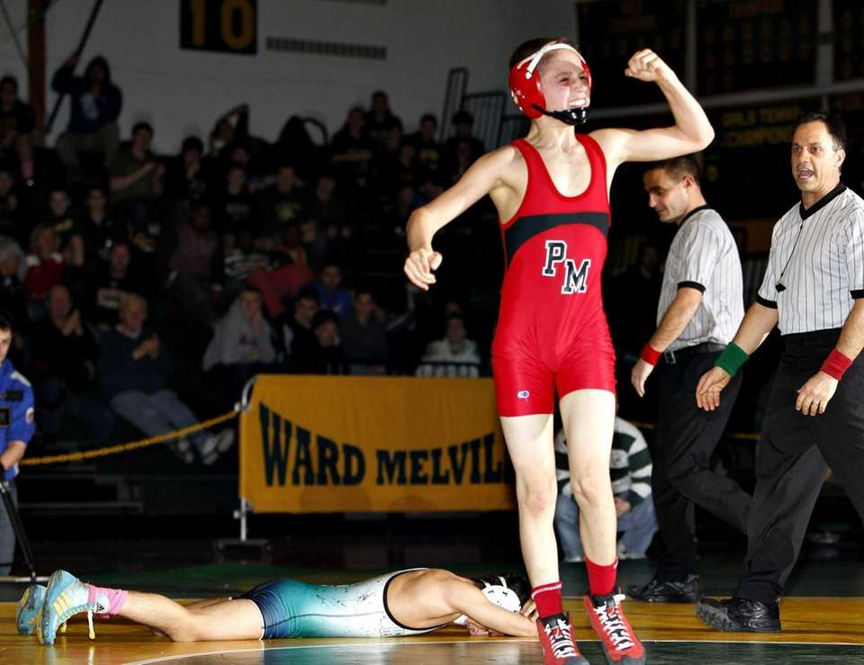 Patchogue's Bobby Pease celebrates his victory over Brentwood's
