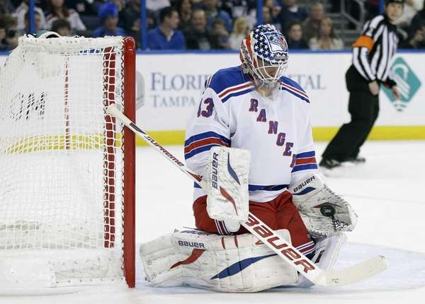 Martin Biron (43) makes a save during a