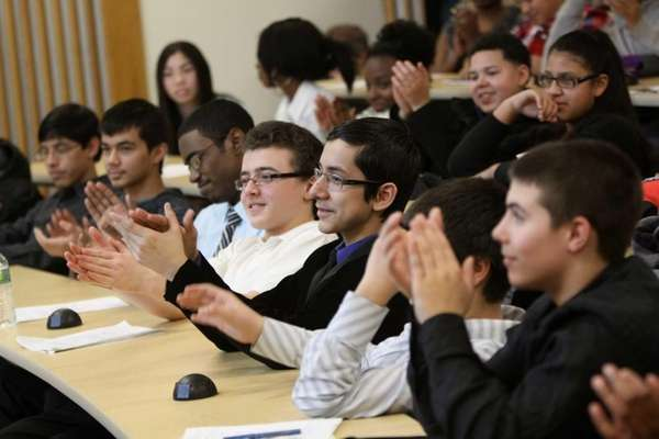Students applaud during an introduction to Farmingdale State