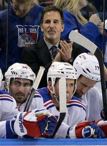 John Tortorella claps during the second period of