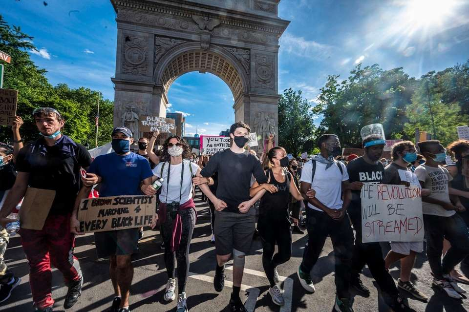 Thousands march up Fifth Ave. for a peaceful