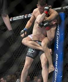 Demian Maia, top, punches Jon Fitch during their