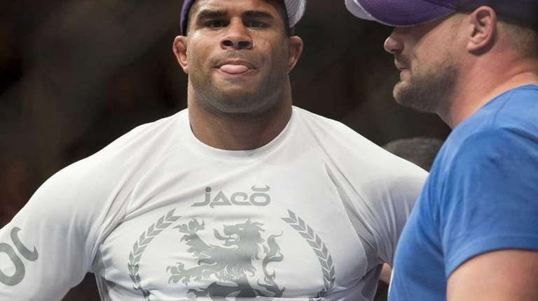 Alistair Overeem reacts to his TKO loss to