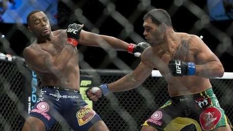 Antonio Rogerio Nogueira, right, trades punches with Rashad