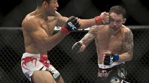 Jose Aldo connects with a left to Frankie