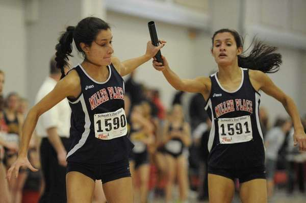 Miller Place's Talia Guevara, left, grabs the baton