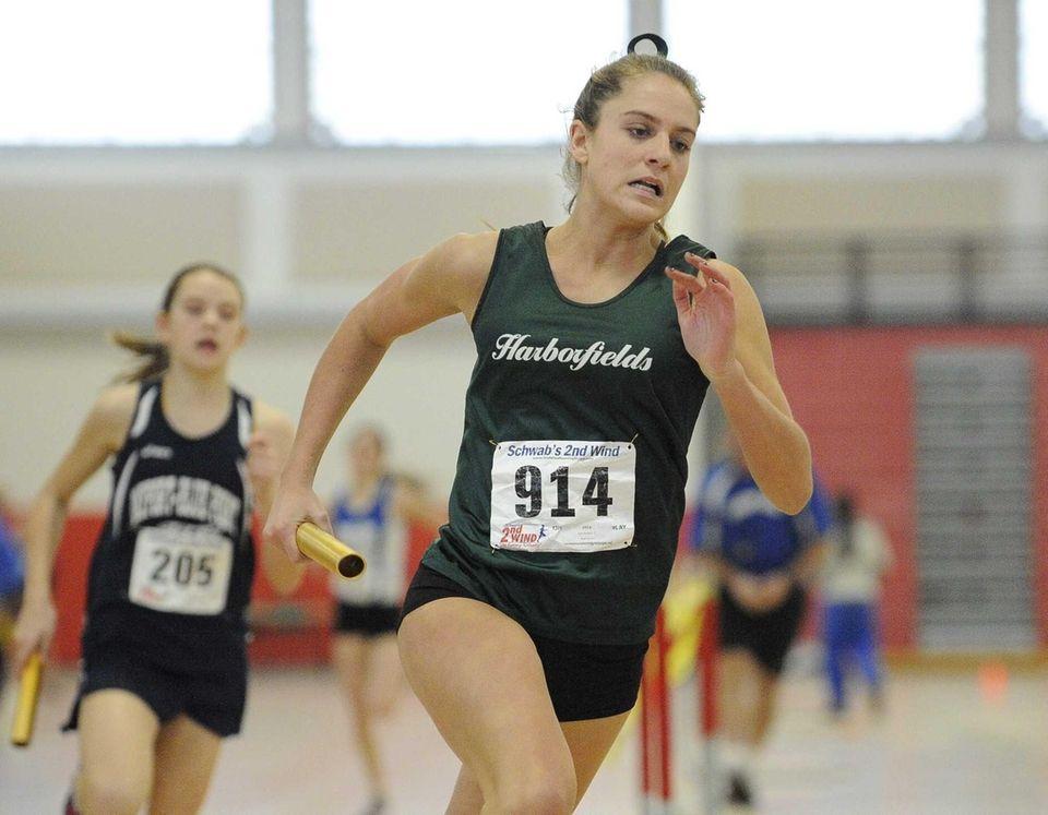 Harborfields' Ana Herbert runs in the 4x400-meter relay.