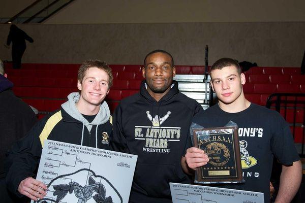 St. Anthony's 132-pound champion Brandon O'Brian, left, coach