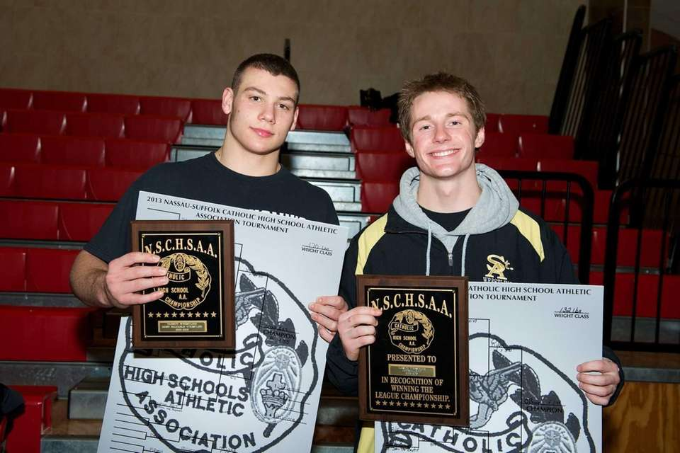 St. Anthony's 132 pound champion Brandon O'Brian, left,