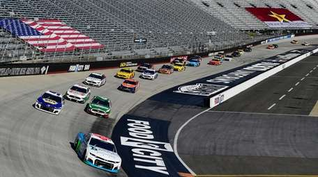 Bubba Wallace, driver of the #43 Chevrolet, leads