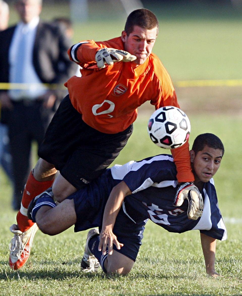 Hills West keeper Alexander Aurrichio dives for a