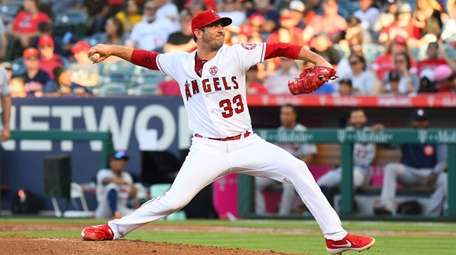 Los Angeles Angels pitcher Matt Harvey throws a