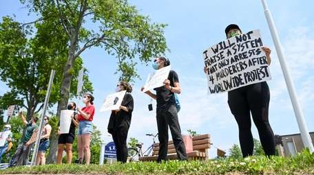 George Floyd protesters stand outside the West Islip