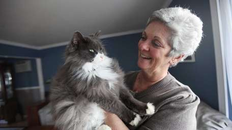 Charlene Lanigan holds her cat McGee at her