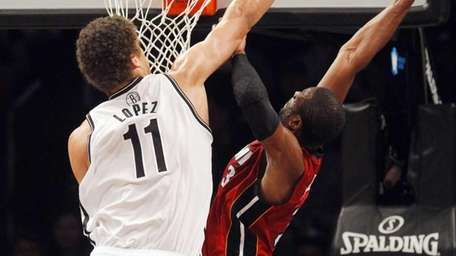 Brook Lopez goes for the block on a