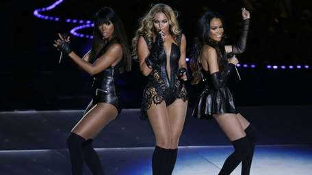 Beyonce performs with Kelly Rowland, left, and Michelle