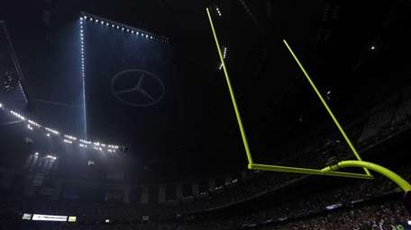 Half the lights are out in the Superdome