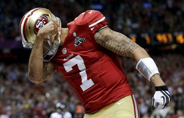 San Francisco 49ers quarterback Colin Kaepernick celebrates his