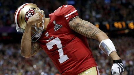 San Francisco 49ers quarterback Colin Kaepernick celebrates his