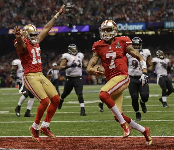 San Francisco 49ers quarterback Colin Kaepernick (7) crosses