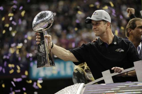 Baltimore Ravens head coach John Harbaugh holds the