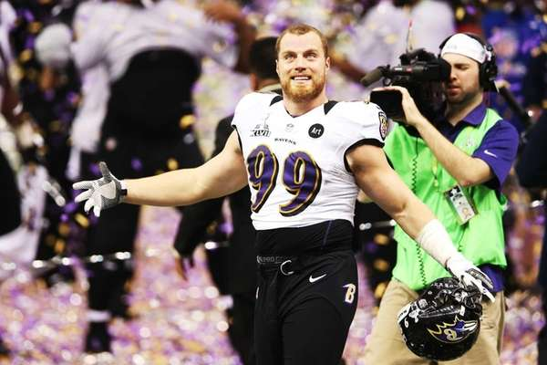 Paul Kruger of the Baltimore Ravens celebrates after