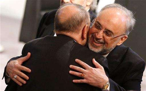 Iranian Foreign Minister Ali Akbar Salehi, right, hugs