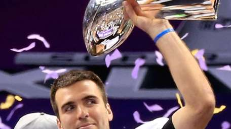 Joe Flacco of the Baltimore Ravens holds up