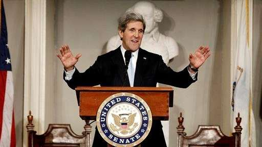 U.S. Sen. John Kerry acknowledges applause while addressing