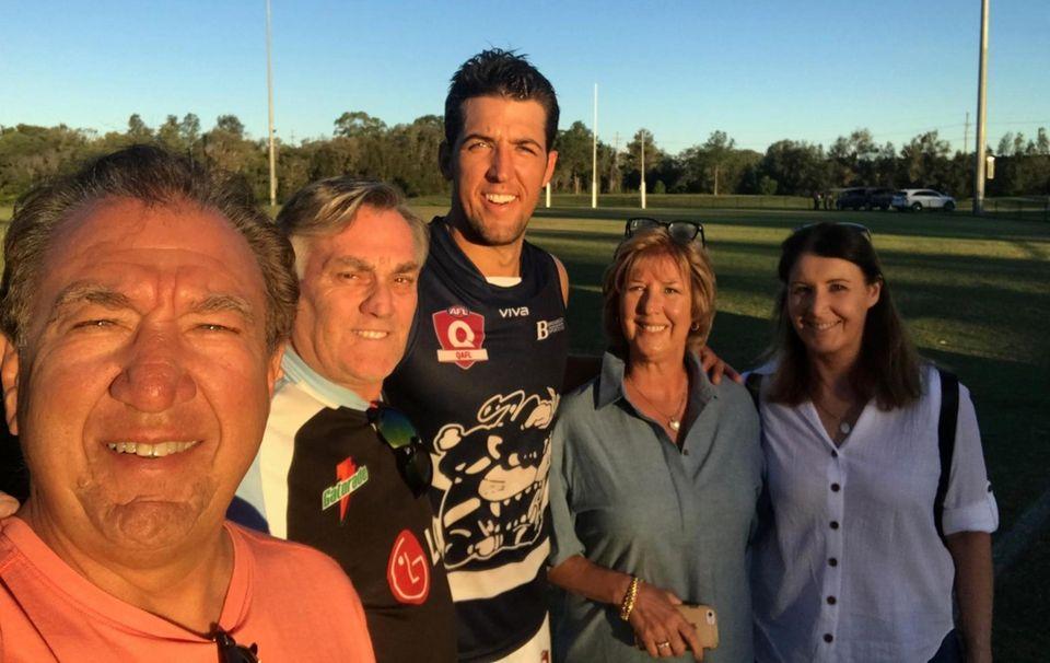 Alex Aurrichio, center, with family members in Australia.