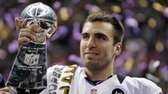 Baltimore Ravens quarterback Joe Flacco holds the Vince