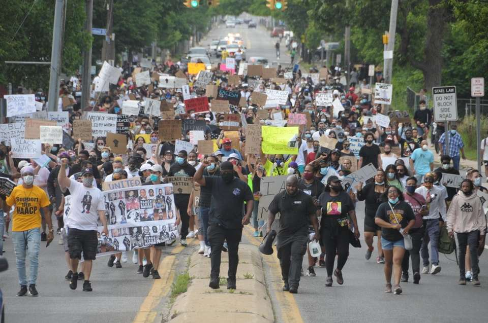 Protesters take a kneeing honor of George Floyd