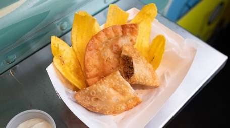 Beef empanadas served with crispy fried plantains at