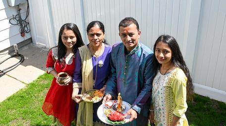 Pinal and Vivek Patel with their daughters Gayatri,