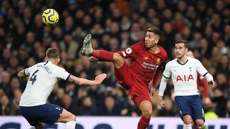 Roberto Firmino of Liverpool controls the ball during