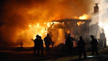 The Smithtown Fire Department battles a fire that
