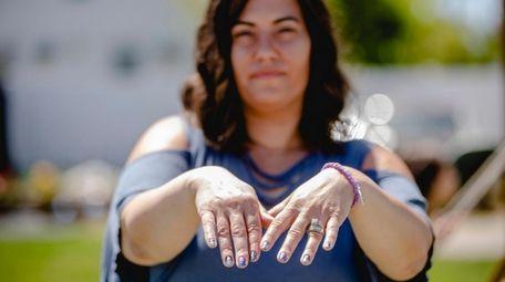 Kelly Pashalidis shows off the press-on nail strips