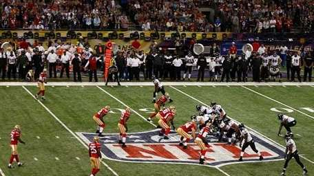 The Baltimore Ravens line up for a play