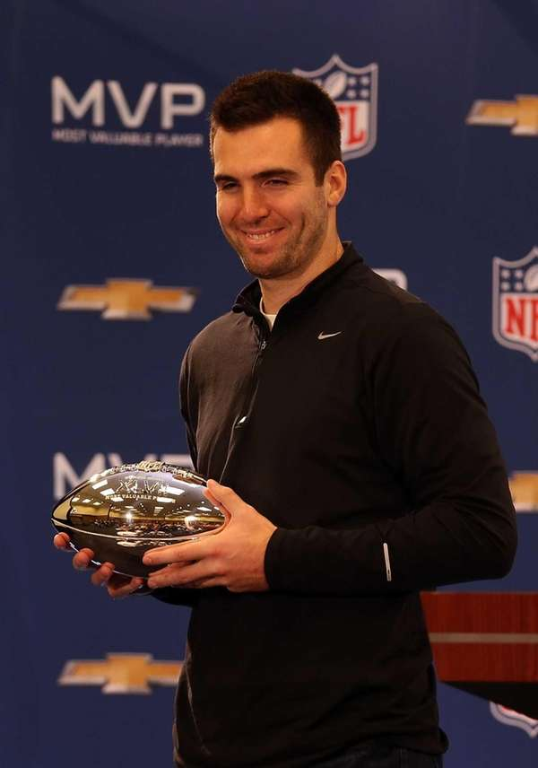 Baltimore Ravens quarterback Joe Flacco poses with the