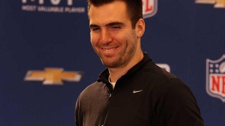 Baltimore Ravens quarterback Joe Flacco poses with the