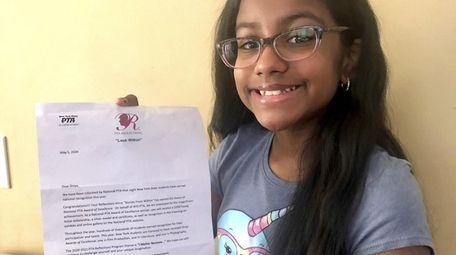 Divya Dindial, a fourth-grader, won an Award of