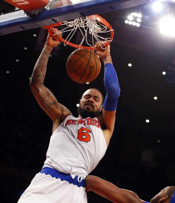 Tyson Chandler dunks the ball in the first