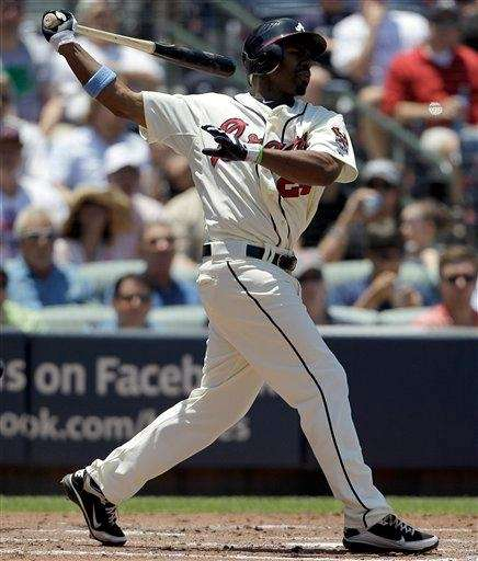 Atlanta Braves outfielder Michael Bourn takes a swing