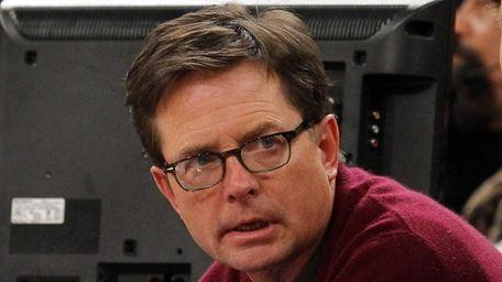 Actor Michael J. Fox attends a game between