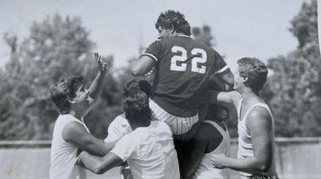 Connetquot's Rob DiLello is carried from field by