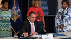 Gov. Andrew Cuomo signs a series of bills