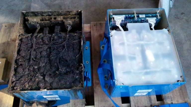 A heat-damaged lithium-ion battery, left, and an undamaged
