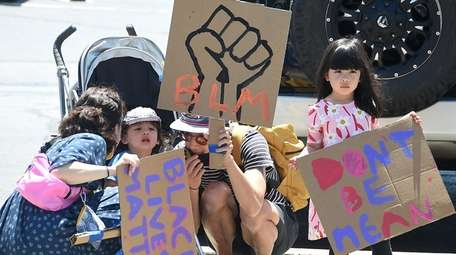 Protesters against police abuse gather on Old Country