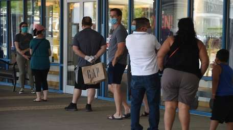 Shoppers at the recently opened Tanger Outlets in