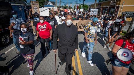 The Rev. Arthur Mackey Jr. walks with protesters